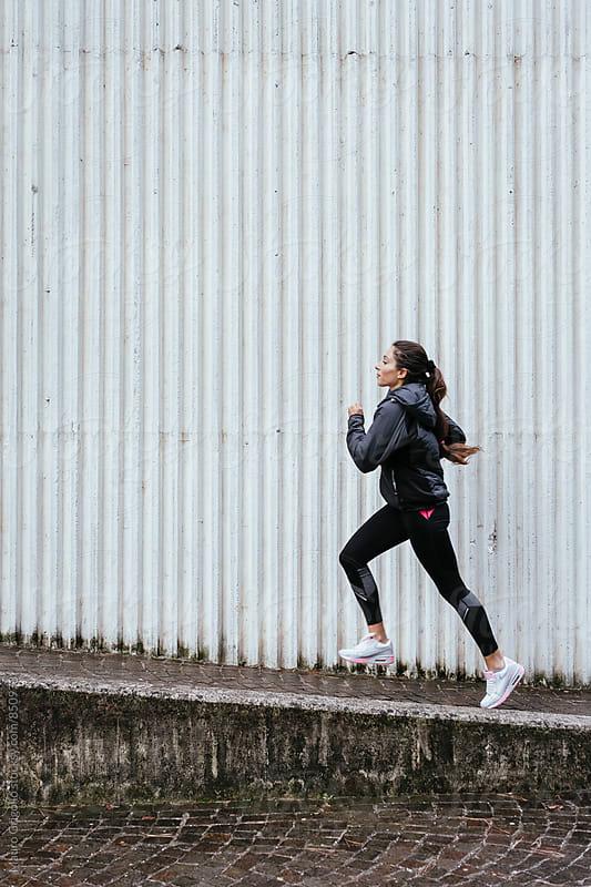 Woman runs outdoor by Mauro Grigollo for Stocksy United