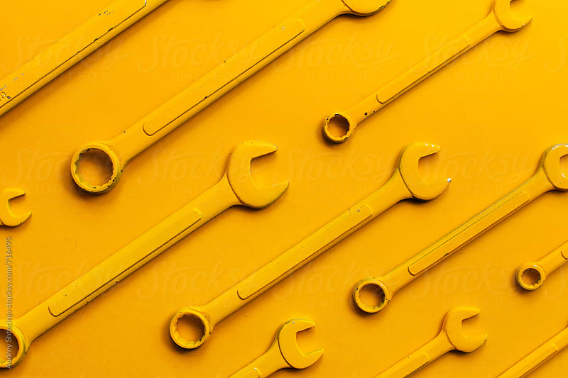 Yellow wrench set on yellow background. by Marko Milanovic for Stocksy United