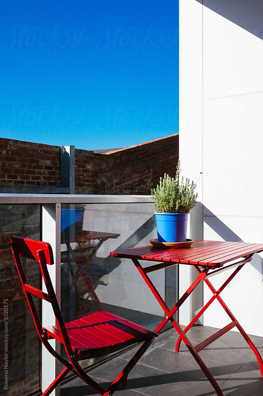 Small patio of hi-rise apartment by Rowena Naylor for Stocksy United