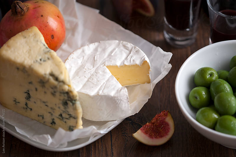 cheese fruit and olives by Lee Avison for Stocksy United