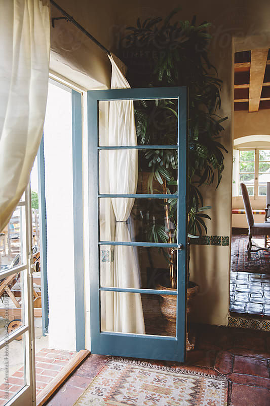 patio door by Nate & Amanda Howard for Stocksy United