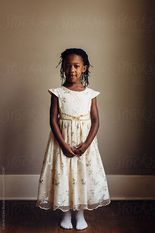 Black girl in white dress by Gabriel (Gabi) Bucataru for Stocksy United