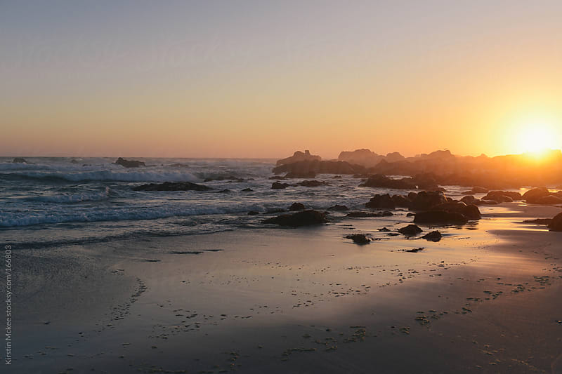 Sunset over a beach in South Africa by Kirstin Mckee for Stocksy United