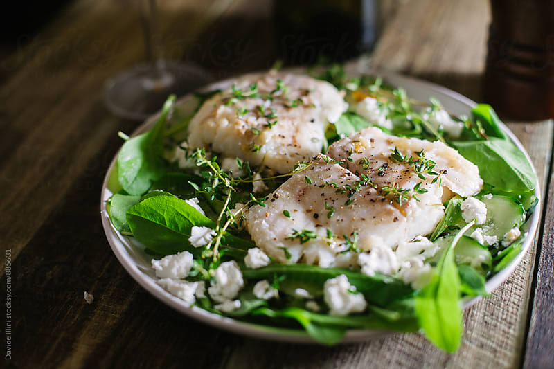 Halibut fillet with salad and Greek feta by Davide Illini for Stocksy United