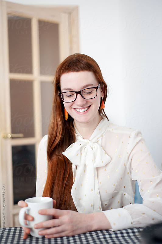 Smiling young woman with a cup by Lyuba Burakova for Stocksy United