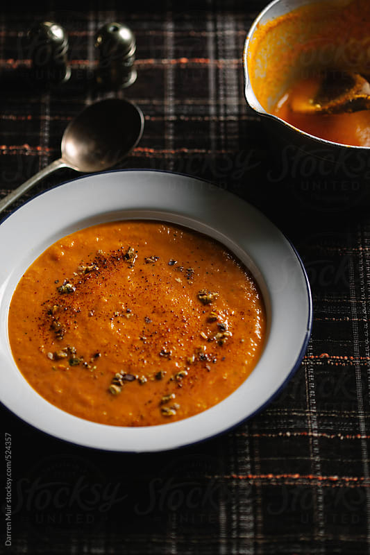 Spicy vegetarian soup. by Darren Muir for Stocksy United