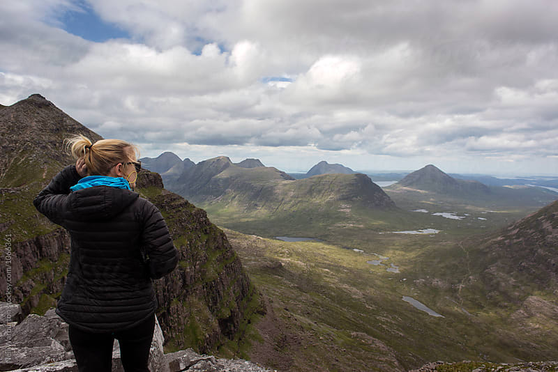 Female hiker taking in the scenic view by Neil Warburton for Stocksy United
