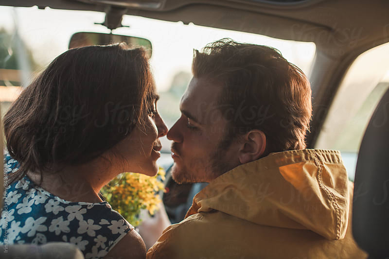 Couple in a right hand drive car by Irina Efremova for Stocksy United