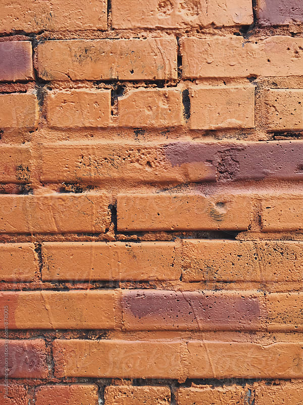 Close up of painted brick wall by Paul Edmondson for Stocksy United