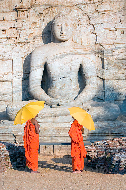 Monks at a rock-cut image of the Buddha in the Gal Vihara, Polonnaruwa (Polonnaruva), UNESCO World Heritage Site, Sri Lanka, Asia by Gavin Hellier for Stocksy United