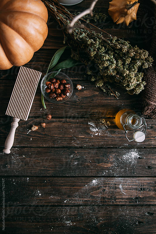 Raw ingredients on a wooden table by Nataša Mandić for Stocksy United