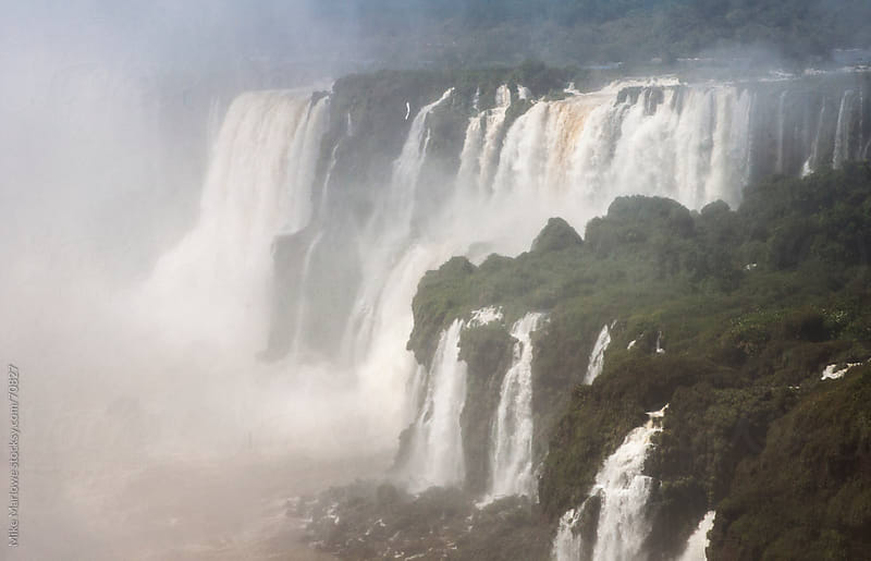 Dramatic shot of Iguazu falls with heavy mist in the air. by Mike Marlowe for Stocksy United
