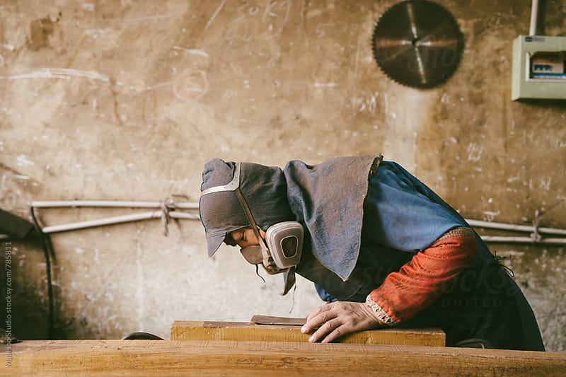Carpenter is working by Maa Hoo for Stocksy United