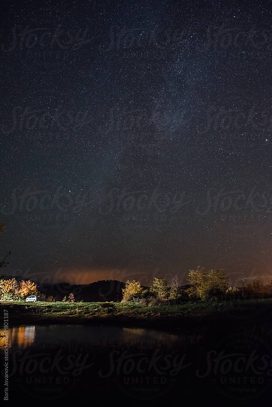Beautiful milky way landscape over the lake  by Boris Jovanovic for Stocksy United