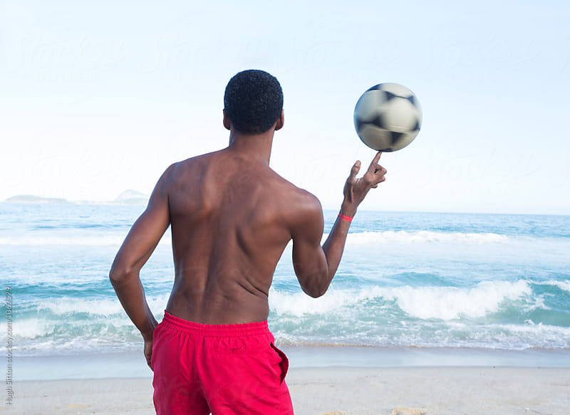 Brazilian man with soccer ball. Ipanema Beach. Rio de Janeiro. Brazil. by Hugh Sitton for Stocksy United