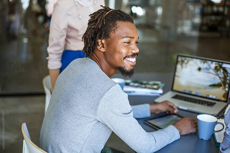 Young African Businessman Working at His Desk by Lumina for Stocksy United