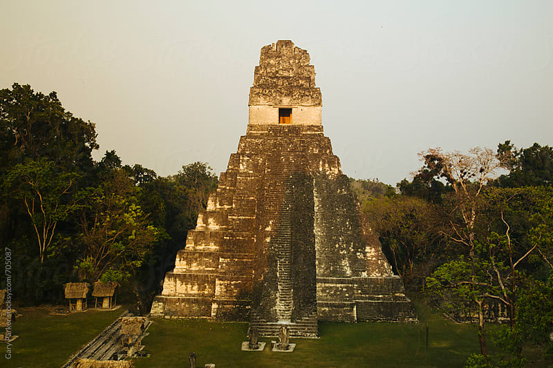 Tikal Pyramid Ruins in Guatemala light up as the sun goes down by Gary Parker for Stocksy United