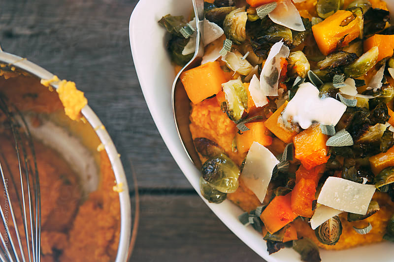 Polenta: Bowl Of Pumplin Polenta With Roasted Vegetables And Cheese by Sean Locke for Stocksy United