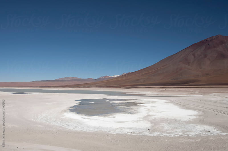 Salt flat with mountain to the side. by Mike Marlowe for Stocksy United