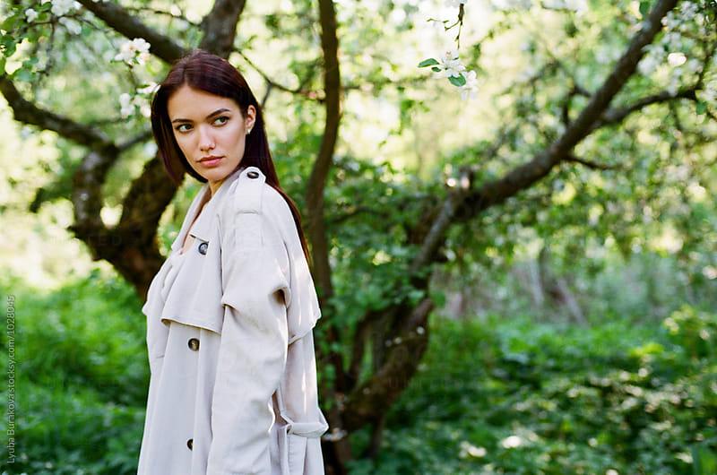 Portrait of young woman by Liubov Burakova for Stocksy United