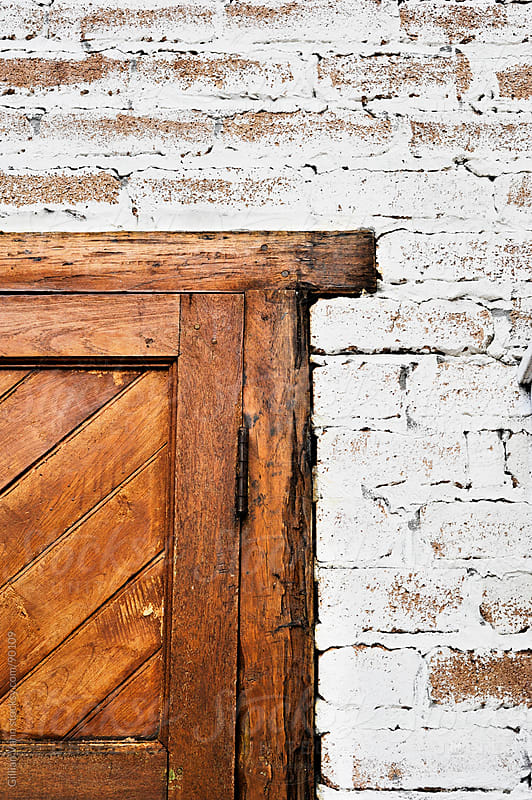 door frame in brick wall by Gillian Vann for Stocksy United