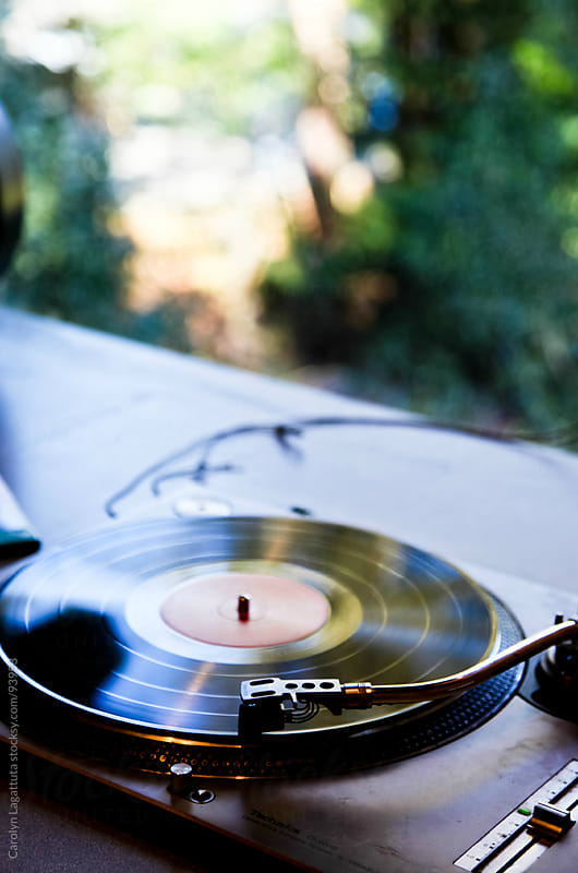 Vinyl record on the turbtable by Carolyn Lagattuta for Stocksy United