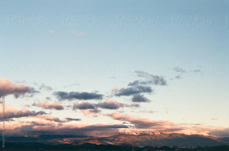 Mountains and clouds in sunset light in Northern California by Briana Morrison for Stocksy United
