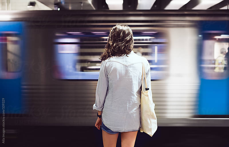 Girl waiting for her train by Aila Images for Stocksy United