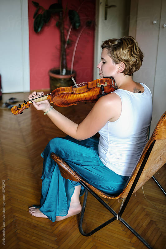 Young Woman Practicing Violin at Home by Aleksandra Jankovic for Stocksy United