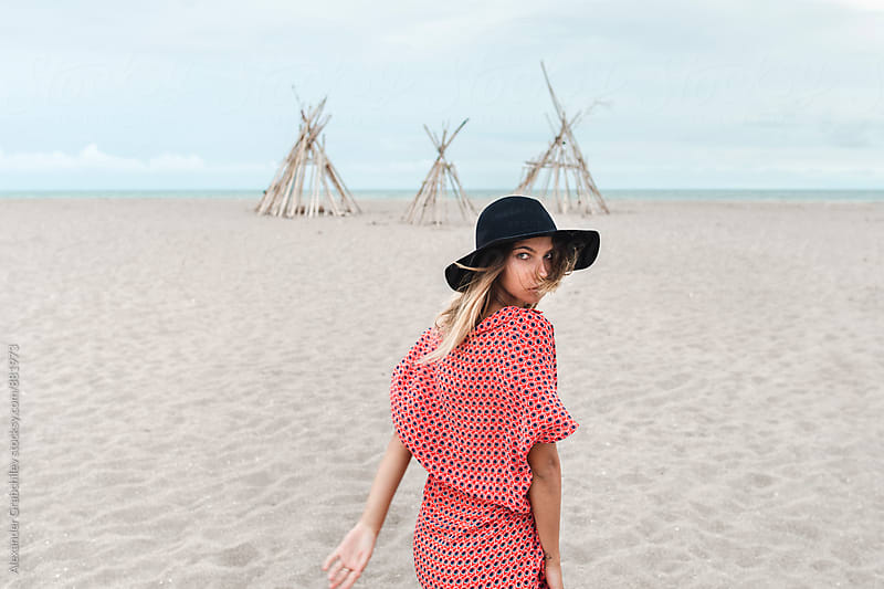 Fashionable Bohemian Woman In Hat On Sandy Beach by Alexander Grabchilev for Stocksy United