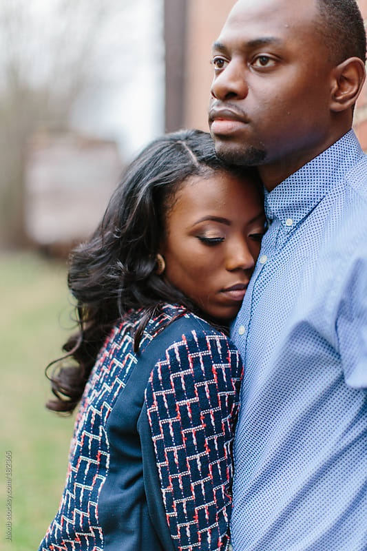 Portrait of a trendy and stylish african-american couple snuggling by Jakob for Stocksy United