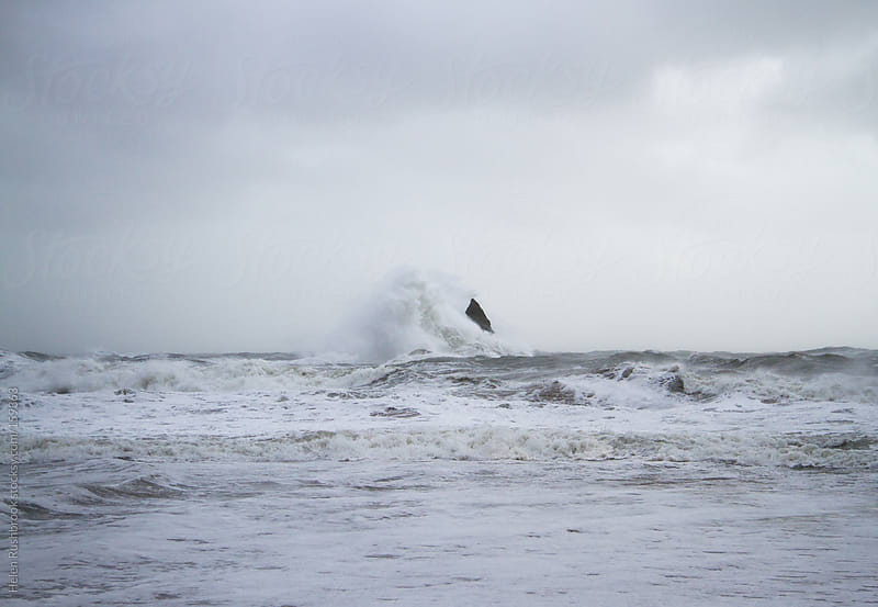 A winter storm at sea by Helen Rushbrook for Stocksy United