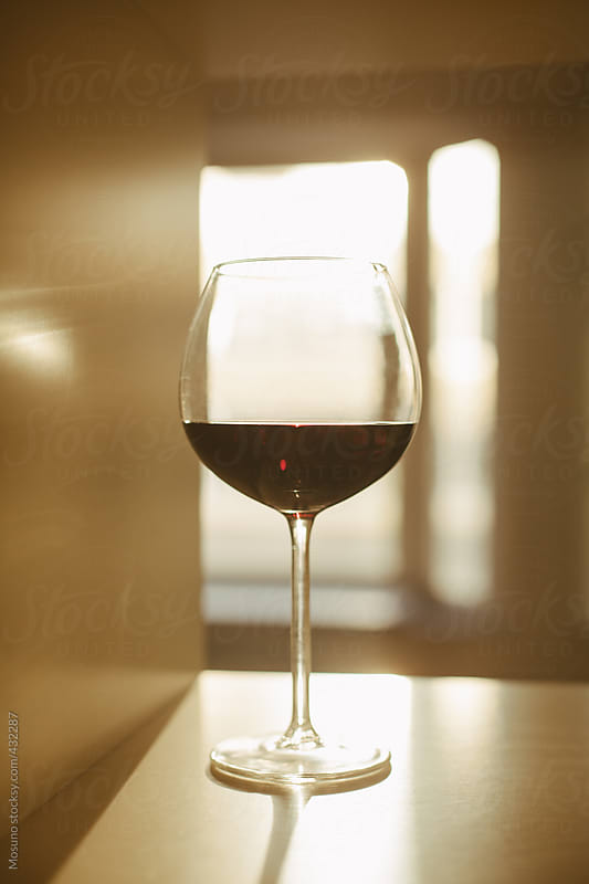 Glass of Red Wine  by Mosuno for Stocksy United