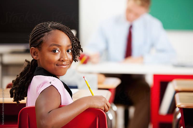 Classroom: African American Student in Classroom by Sean Locke for Stocksy United