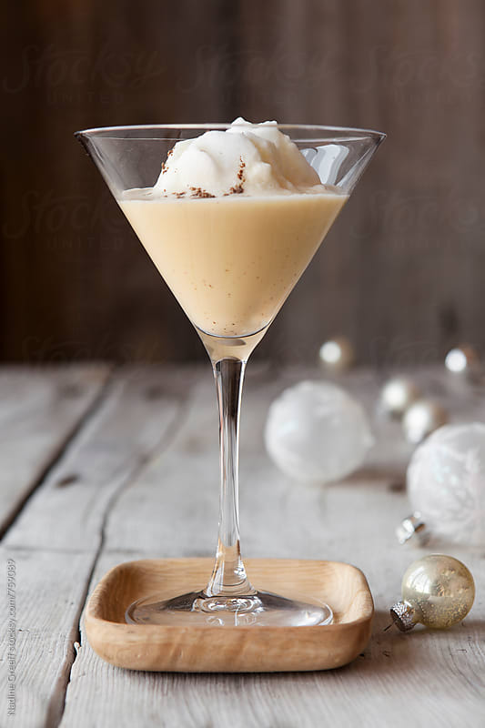 Toast the holidays in style with an elegant eggnog  martini drink. Serve with whipped egg white by Nadine Greeff for Stocksy United