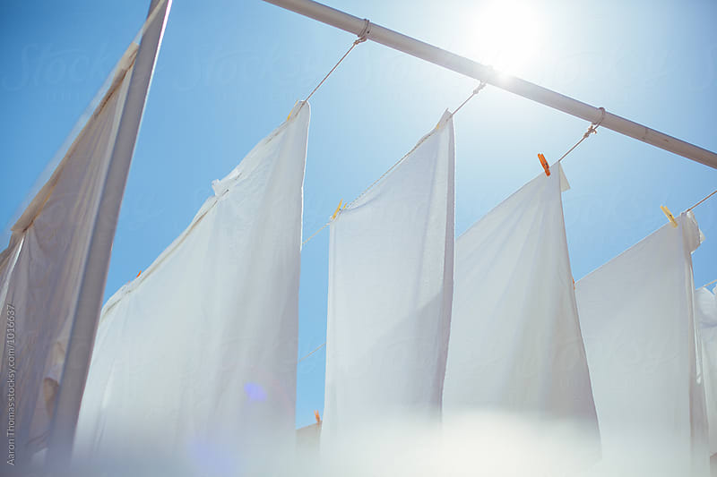 Laundry on Clothesline by Aaron Thomas for Stocksy United