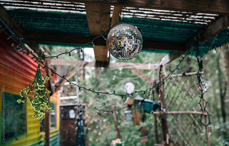 Campsite decorated with disco ball, dried flowers and lights by Carolyn Lagattuta for Stocksy United
