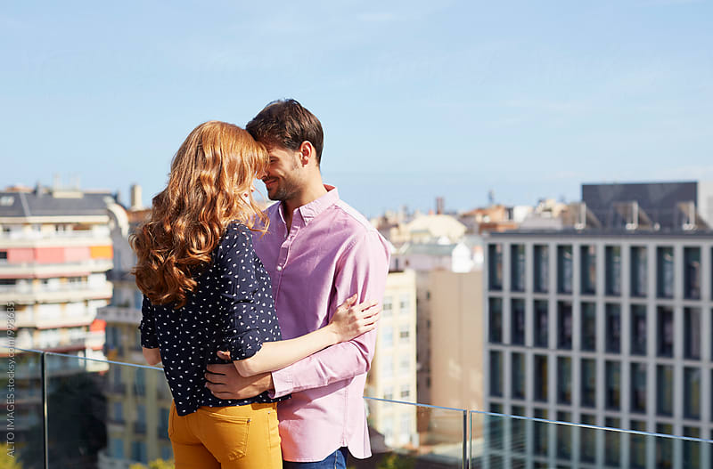 Romantic Couple Embracing On Hotel Terrace by ALTO IMAGES for Stocksy United
