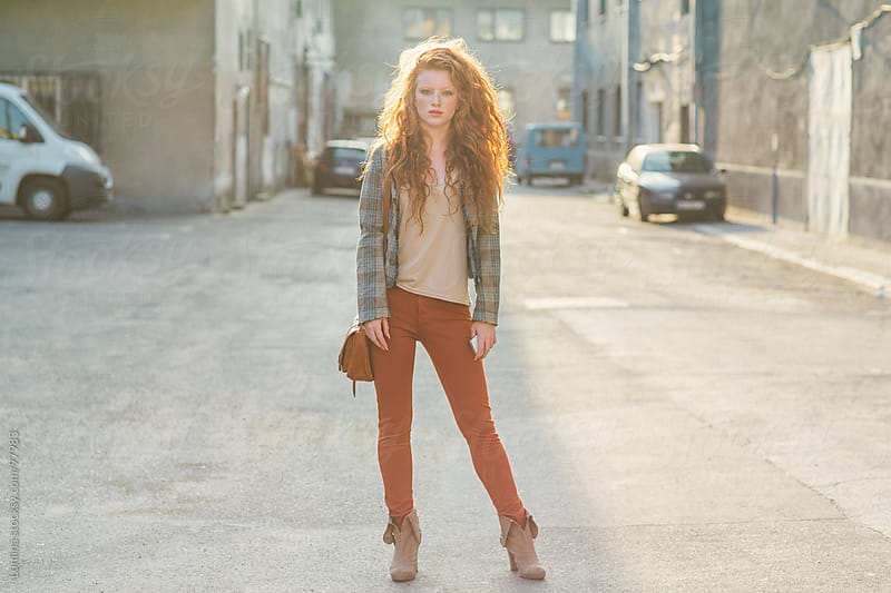 Young Red-Haired Woman on the Street by Lumina for Stocksy United