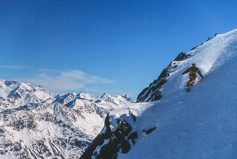 Man skiing powder snow in winter mountain landscape in Austria. by Soren Egeberg for Stocksy United