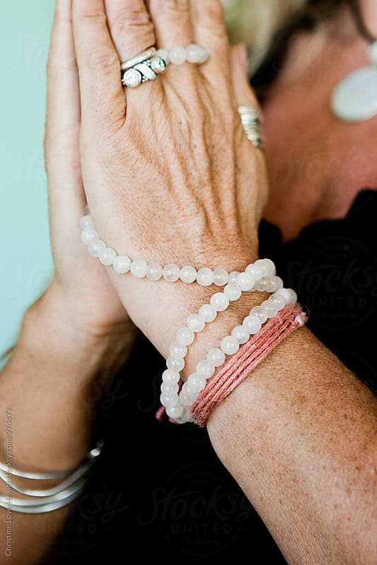 Mala / prayer beads  by Christine Love Hewitt for Stocksy United