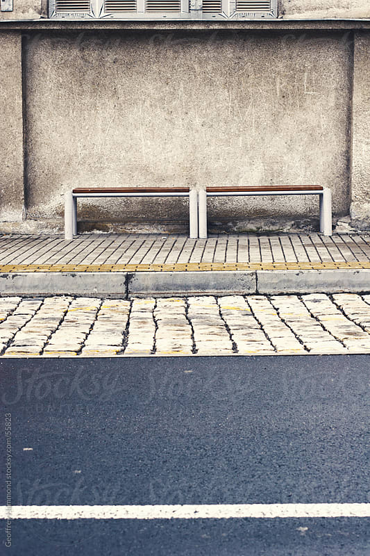Bus Stop Benches in Eastern European City by Geoffrey Hammond for Stocksy United