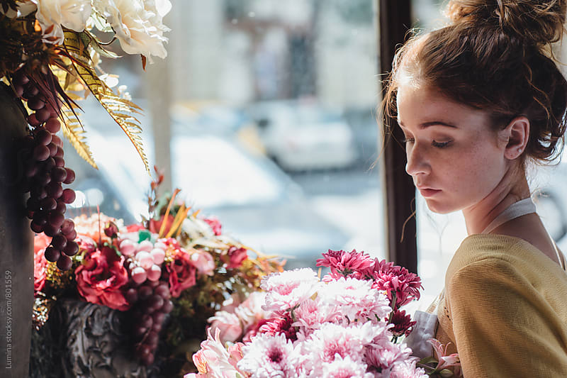 Ginger-Haired Woman Holding a Flower Bouquet in a Flower Shop by Lumina for Stocksy United