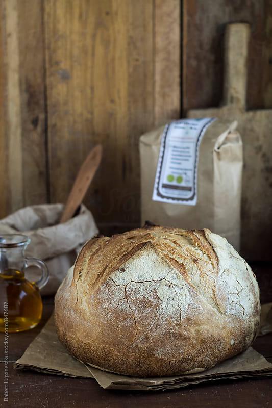 Handmade rustic bread by Viktorné Lupaneszku for Stocksy United
