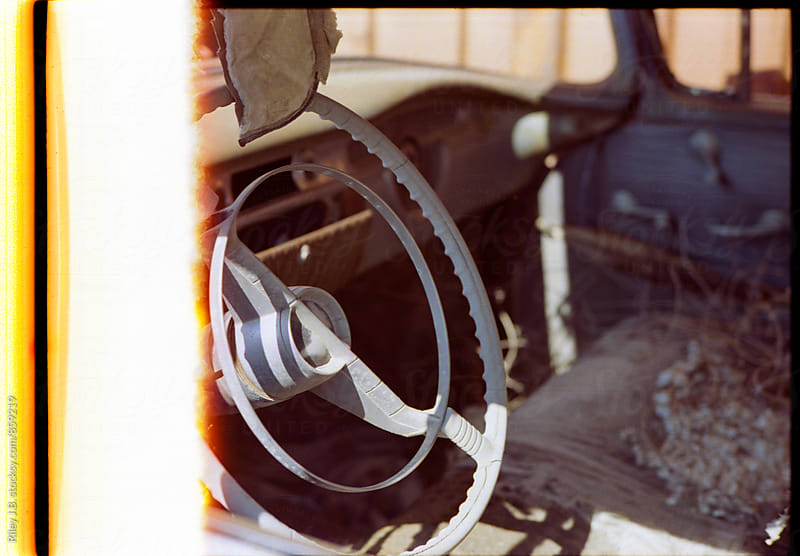 Start of the film roll - Interior of destroyed classic car by Riley J.B. for Stocksy United