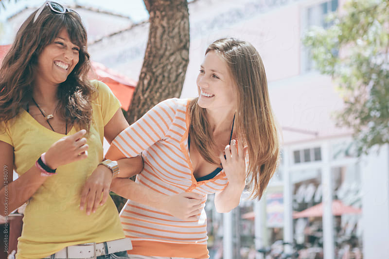 Two Young Women Students on Spring Break in South Beach Miami by Joselito Briones for Stocksy United