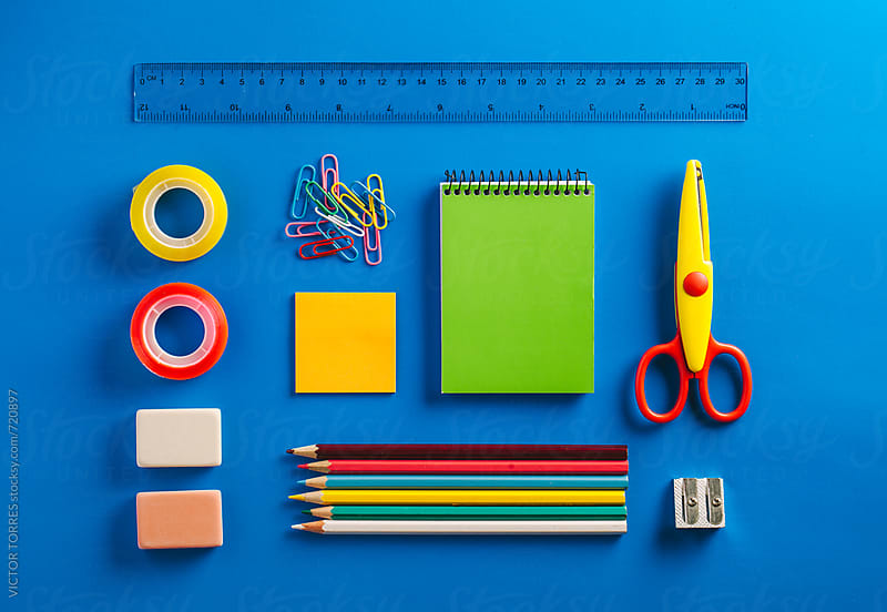 Schools supplies on a Blue Background by Victor Torres for Stocksy United