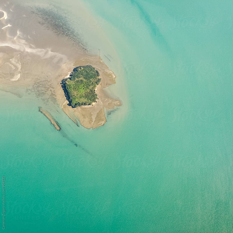 small island from airplane window by Cameron Zegers for Stocksy United