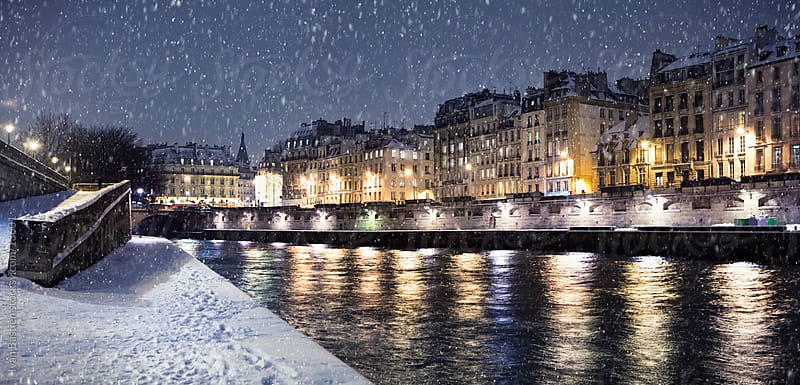 Quayside along River Seine on a snowy night by Ivan Bastien for Stocksy United