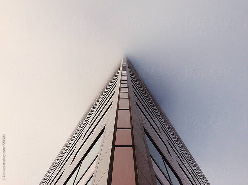Skyscraper Covered in Fog by B. Harvey for Stocksy United